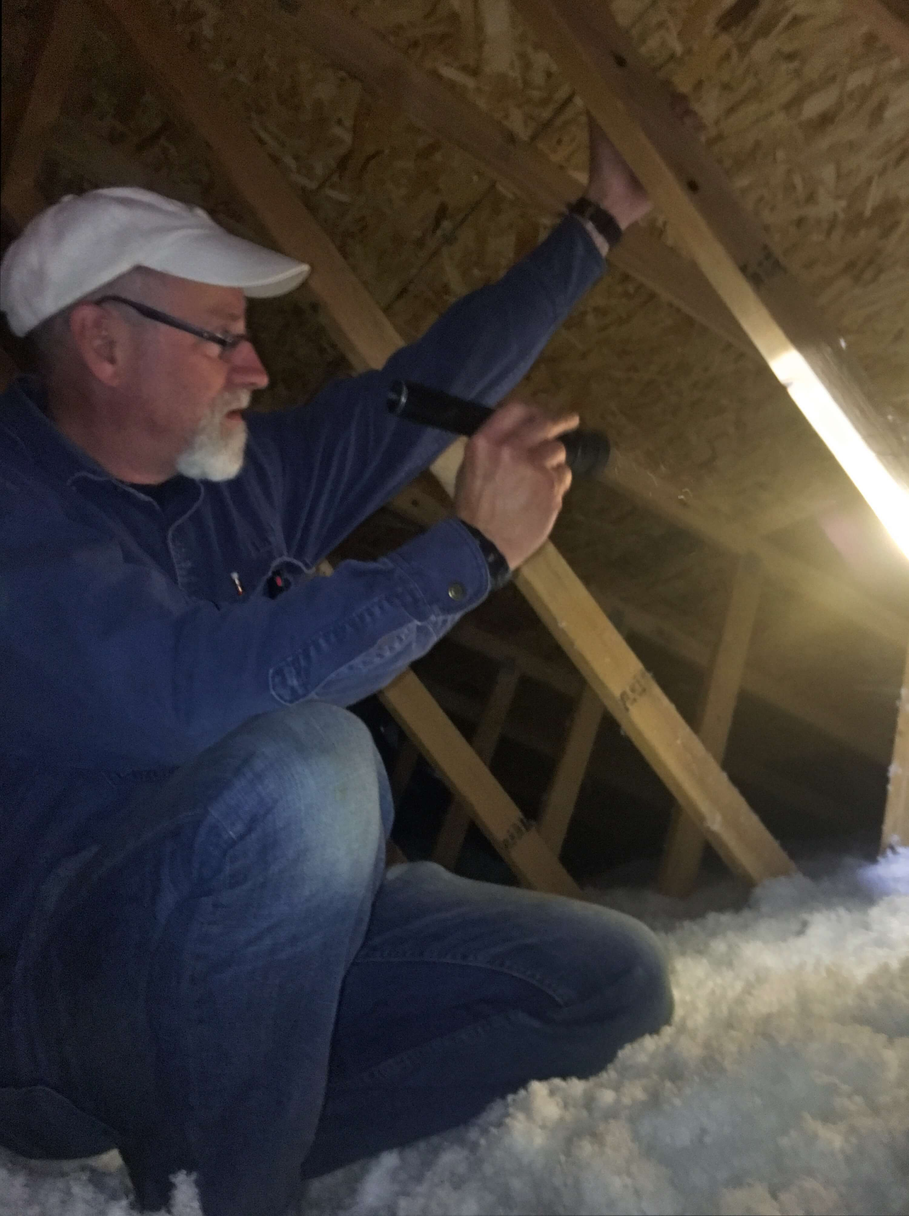 inspector checking support in attic