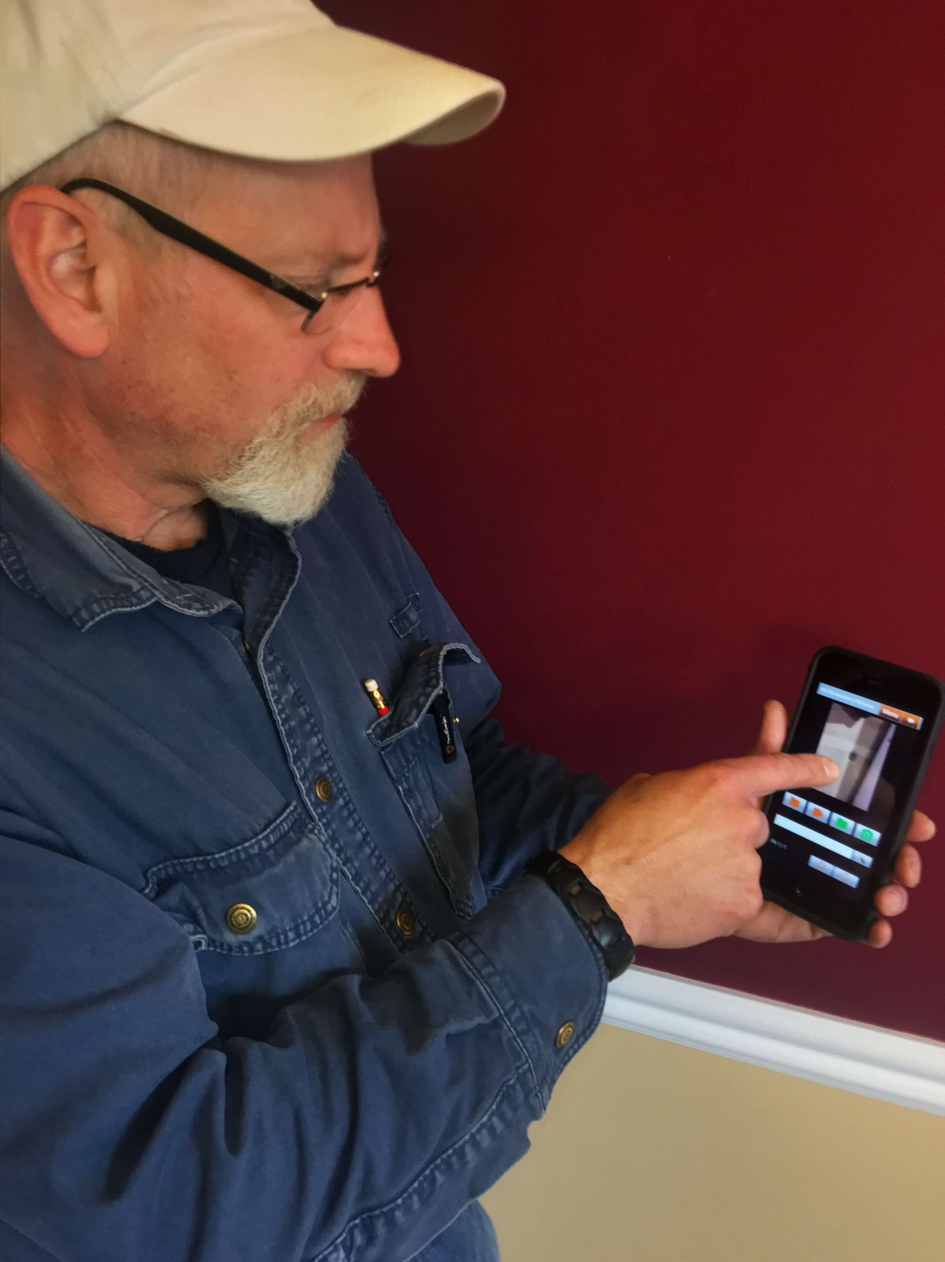home inspector showing digital report