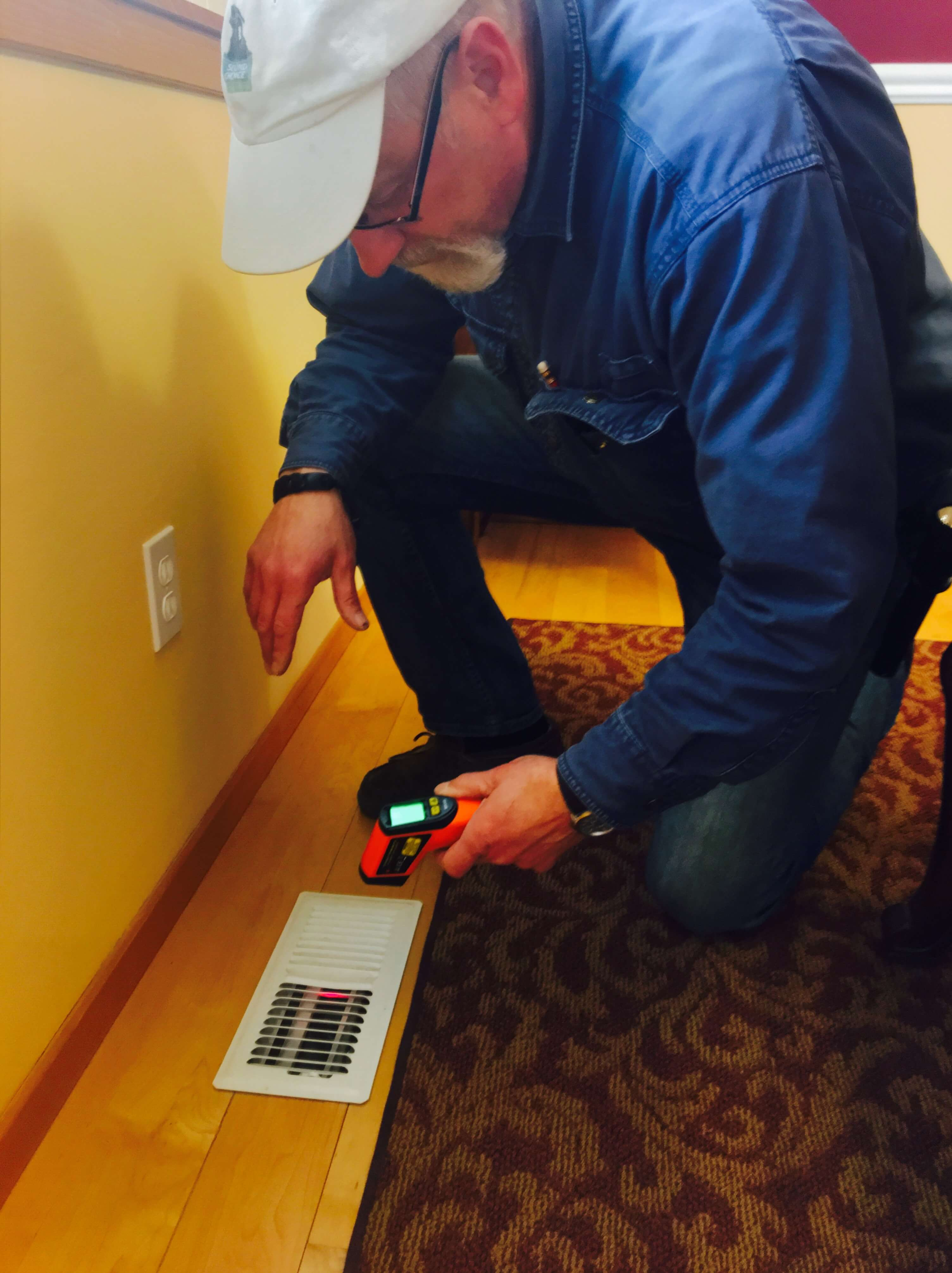 inspector testing temperature from vent
